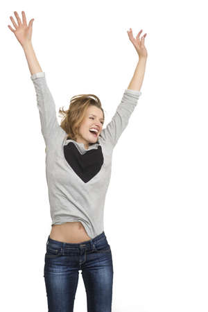 Woman jumping and smiling happy portrait  Fresh and beautiful with symbol of heart in casual grey top isolated on white background