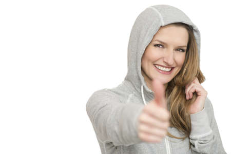 Young sport woman showing thumbs up gesture, isolated over white background