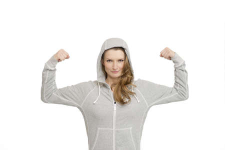 Young sport woman showing arms and biceps isolated over white background