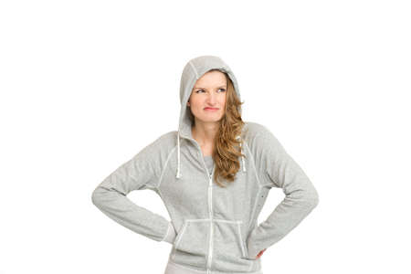 Confused young sport woman looking away - portrait of bored and dissatisfied woman with white background Stock Photo