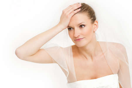 stressful: Bride pulling her hair and making a stressful facial expression - nervous and headache Stock Photo