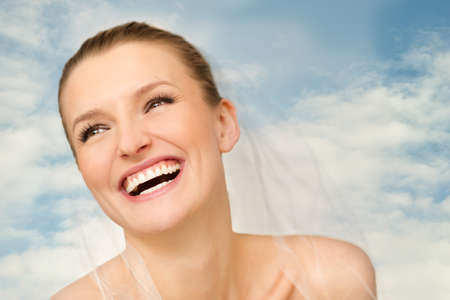 Portrait of beautiful bride with blue sky in background photo