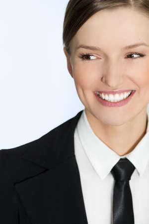 Businesswoman smiling - close portrait of woman