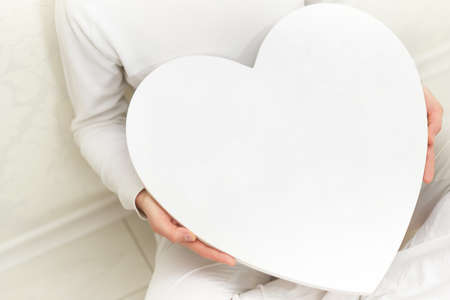 Valentines woman and heart symbol in hands - love Stock Photo