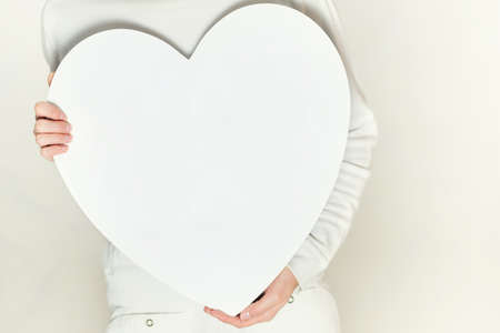Valentines woman and heart symbol photo