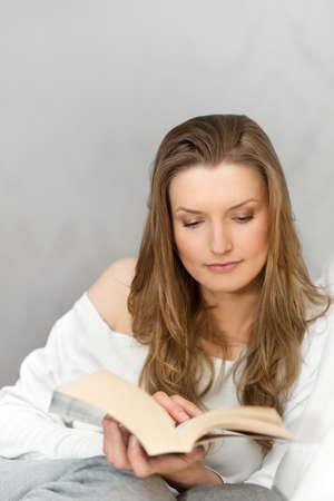 Woman reading book at home and relaxing