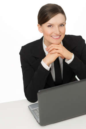 Business smiling woman with laptop sitting photo