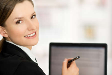 Business woman showing blank laptop screen ready for text