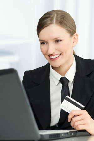 Woman online shopping with a credit card - laptop Stock Photo