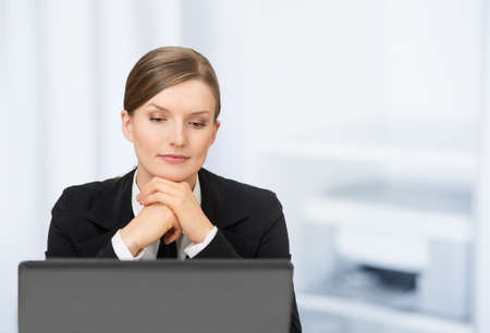 One beautiful business woman with laptop in the office Stock Photo