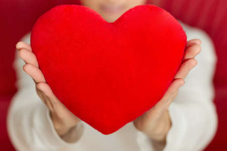Symbol of heart in hands - love and Valentines Day Stock Photo