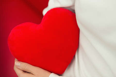 Red heart and love on hands - Valentine