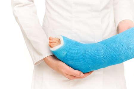 Caring nurse taking care of little broken leg of child