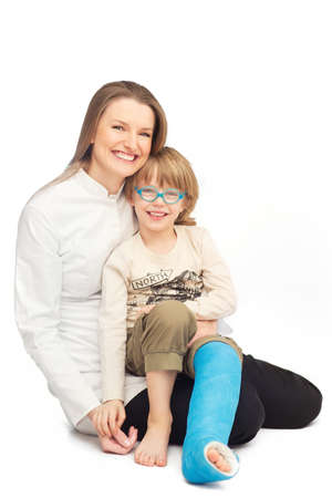 Young mother with her smiling son - portrait on the floor Stock Photo