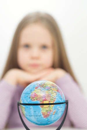 Girl and globe photo