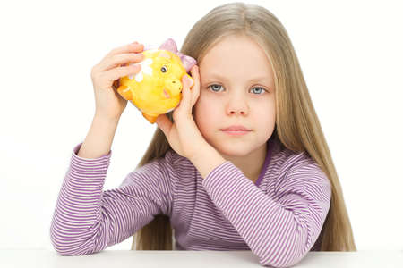 Picture of lovely small girl with piggy bank Stock Photo
