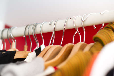 Row of women s clothes hanging in closet Stock Photo