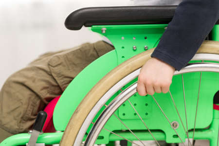 Disabled child on wheelchair
