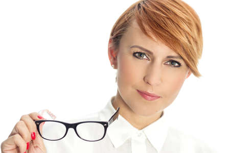 Close-up of a confident young businesswoman with glasses