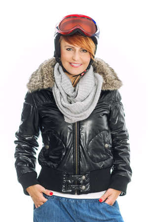 parka:  Winter woman in jacket, helmet and goggles Stock Photo