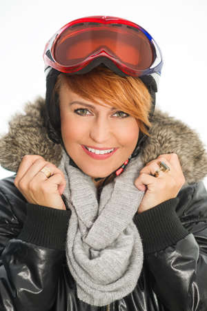 parka: Winter woman in black jacket, helmet and goggles Stock Photo