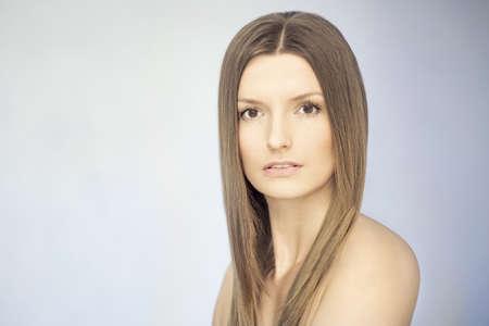 Elegant nude girl with magnificent hair  Studio portrait  Stock Photo
