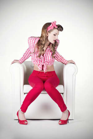 Pin-up sitting on Armchair Stock Photo