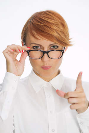 Businesswoman Wearing Glasses and Pointing Finger Stock Photo