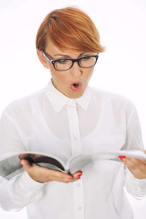 Surprised woman reading the newspaper Stock Photo