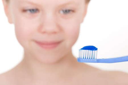 Child brushing teeth - smiling girl