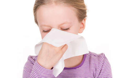 Child and girl - illness, runny nose, tissue and blowing nose Stock Photo