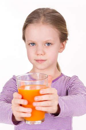 Young girl drinking orange juice - healthy life