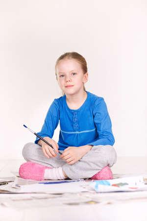 Little Girl Painting on the Floor Stock Photo