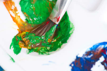 Close-up of paint brush and palette