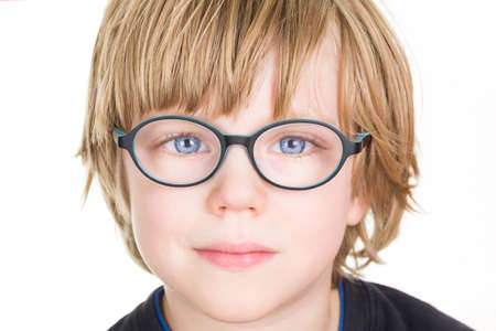 eyesight: Beautiful boy with glasses Stock Photo