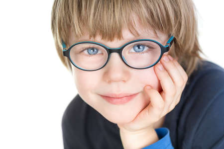 myopia: Adorable cute boy with glasses - portrait