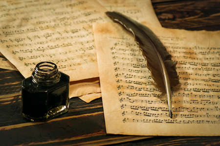 musical score: Quill, the inkwell and the scroll with musical notation