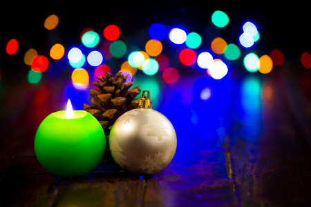 Concept of Christmas, candle with Christmas. Christmas bauble and the cone