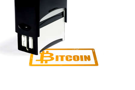Bitcoin concept, black rubber stamp with golden inscription on white isolated background. Reklamní fotografie