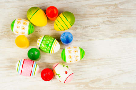 Easter concept, colorful Easter eggs with paints on a background of boards in vintage style Reklamní fotografie