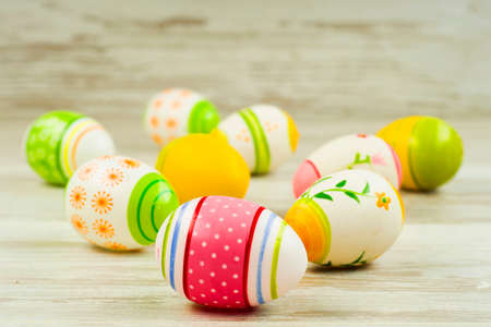 Easter concept, colorful Easter eggs on a background of wooden boards in vintage style