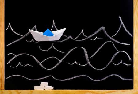 Paper ship on the background of a chalkboard Stok Fotoğraf