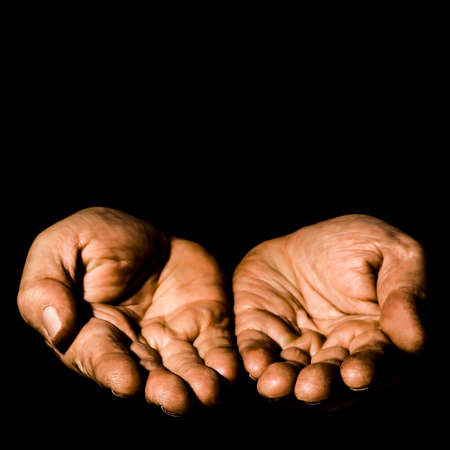 Two hands on a black background isolated Stok Fotoğraf