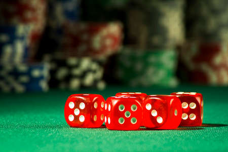 The concept of gambling - bones on the background of tokens for dresses