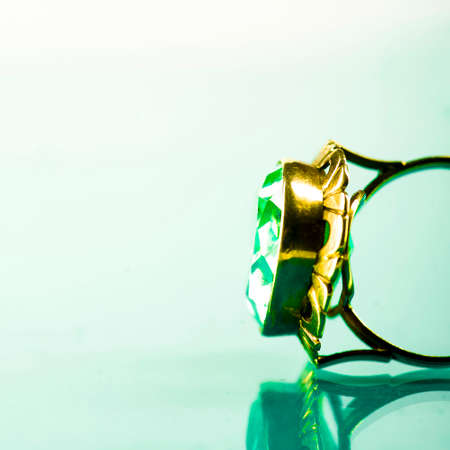Gold-rimmed ring with sapphire on light sapphire