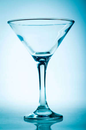 A martini glass isolated on a blue background 免版税图像