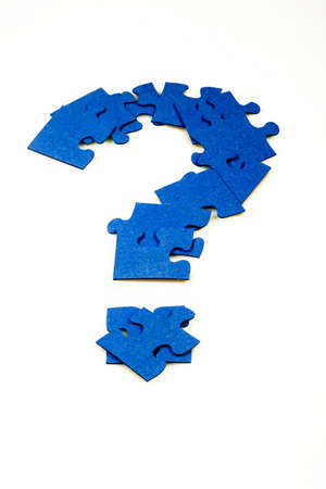 Blue puzzle in the shape of a question mark on a white isolated background Stock Photo