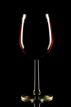 A glass of red alcohol isolated on a black background 免版税图像