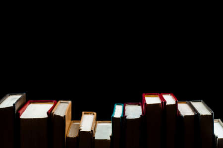 A stack of books on a black background