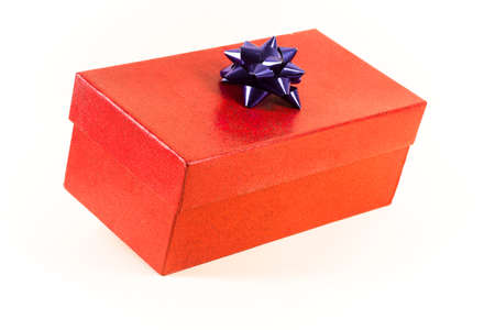 A red gift box with a blue bow, isolated on a white background
